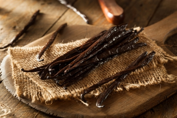 Raw vanilla beans on a cutting board
