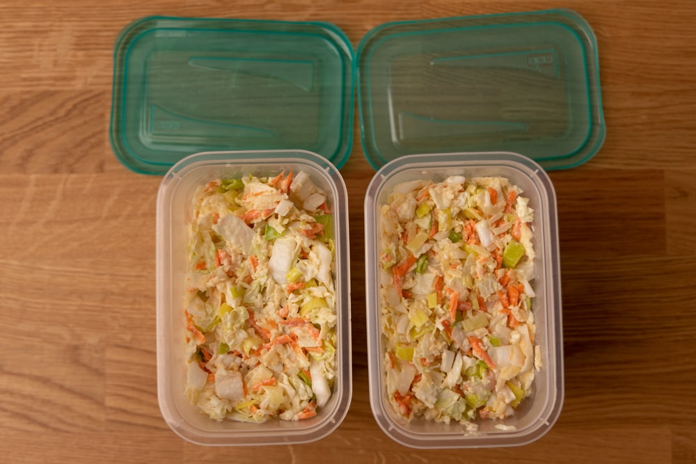 Salad with leek in containers
