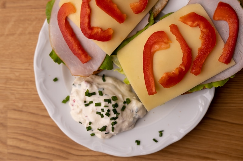 Sandwiches and cream cheese with radishes