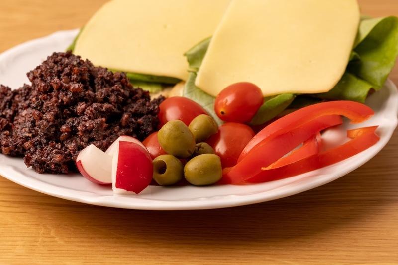 Sandwiches, olives, and veggies