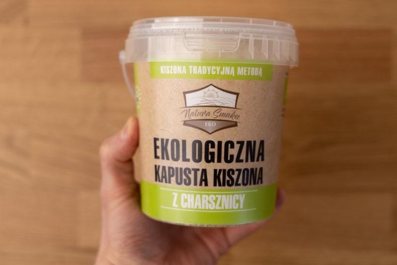 Sauerkraut container in hand