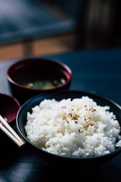 Sesame rice in a black bowl