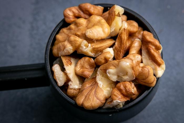 Shelled walnuts in a scoop