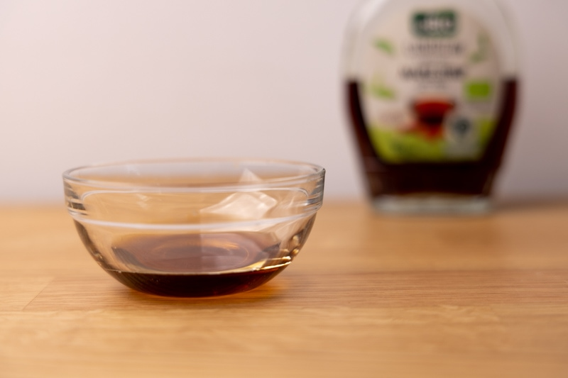 Small bowl of maple syrup