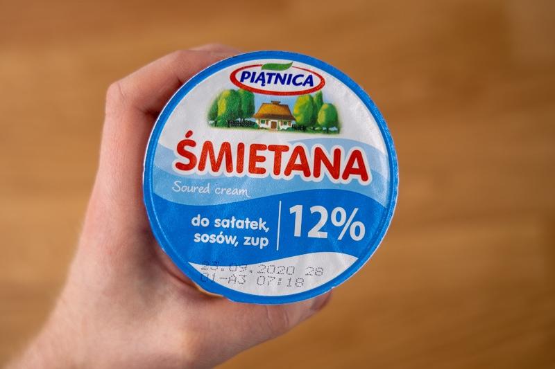 Sour cream in hand