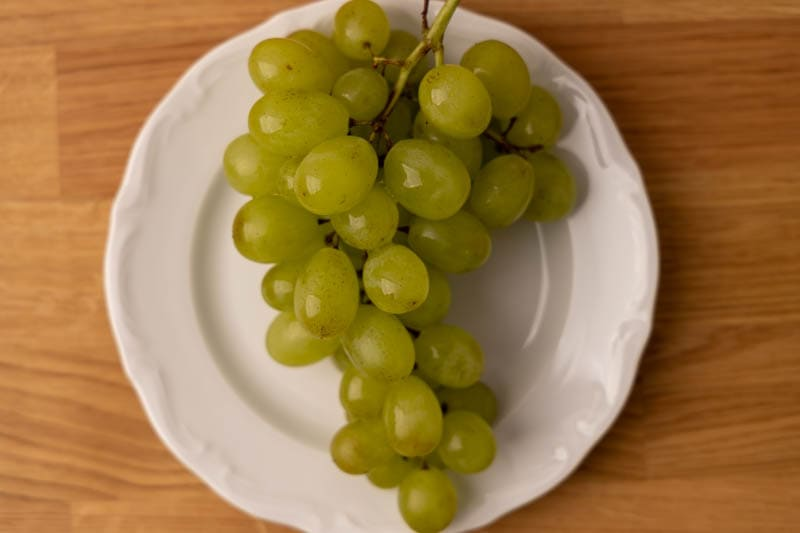 Sprig of grapes on a plate