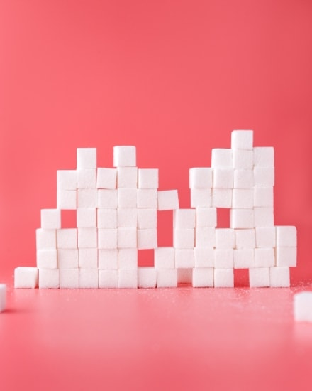 Sugar cubes on red background