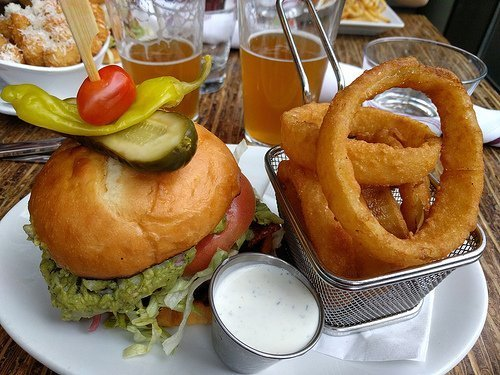 Torta burger with onion rings and ranch dressing