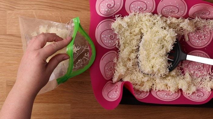 Transferring frozen mozzarella into a bag