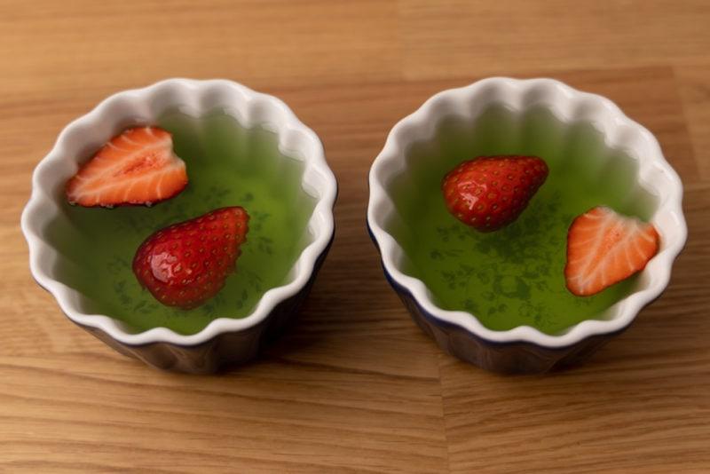 Two jello desserts with strawberries