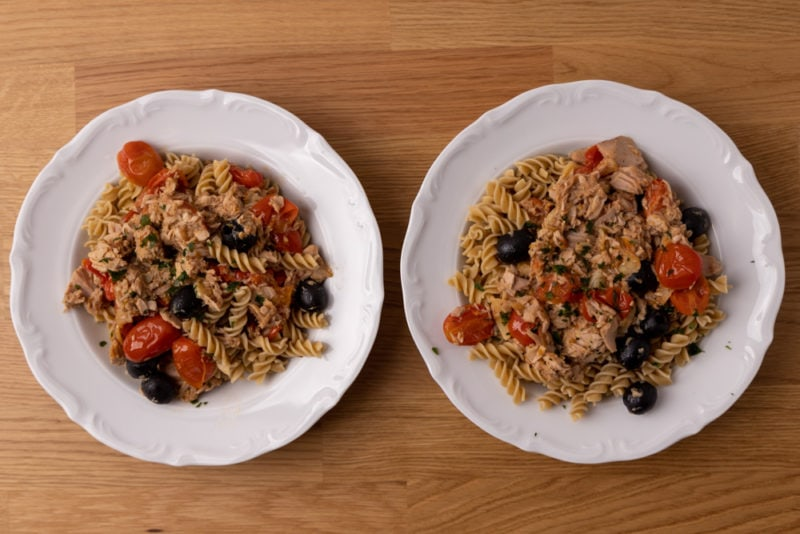 Two plates of pasta salad for dinner