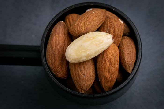 Unpeeled almonds in a scopp