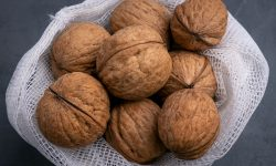 Unshelled walnuts in a mesh bag