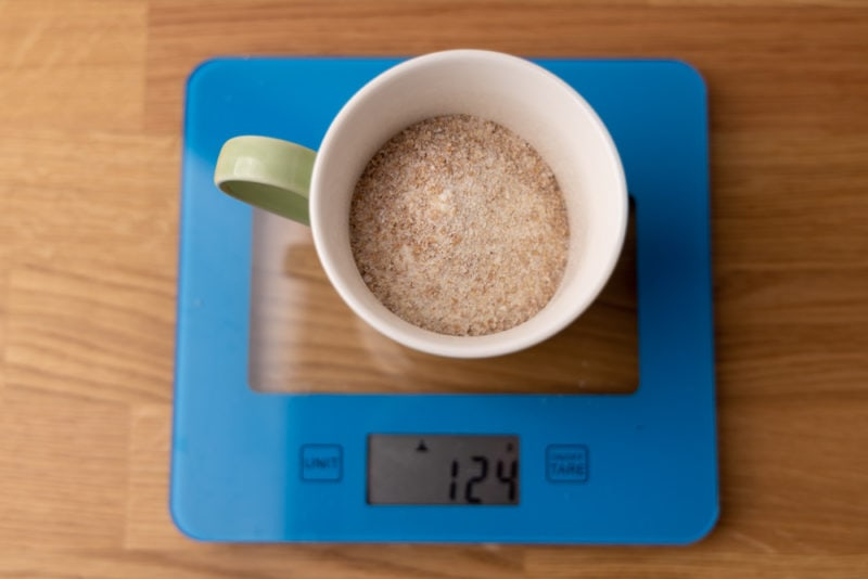 Weighing flour in a cup